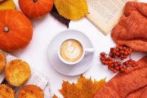 Cozy autumn layout with coffee and maple leaf, pumpkin, sweater and book photo