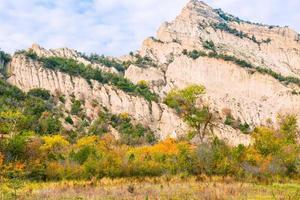 Stunning sharp edge cliff in vashlovani national park area with beautiful colorful autumn trees photo