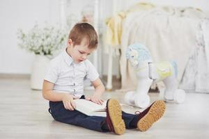 Boy reading a book. Education, Knowledge, getting ready for school photo