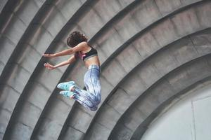 Photo of a beautiful woman doing parkour
