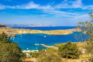 Lindos Beach bay panorama with turquoise clear water Rhodes Greece photo