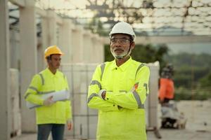 Supervisor and engineering in the construction site and blueprint photo