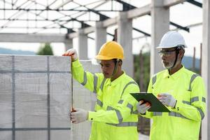 Quality inspection of aerated concrete blocks used in construction by engineers and experts photo