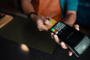 Payment by credit card via credit card swipe machine photo