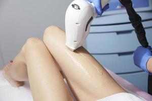 Beautician Giving Epilation Laser Treatment To Woman photo