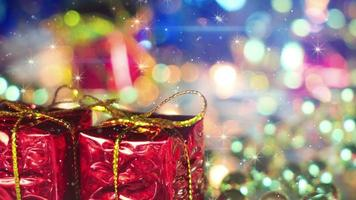 Christmas gift boxes and shimmering particles loopable video