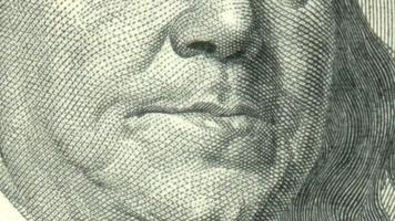 Animation of close-up of Ben Franklin winking on US one hundred dollar bill video