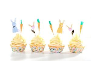 Cupcakes Decorated Treats on White Background for Easter photo