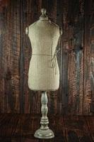 Antique Mannequin Busts on Wood Grunge Background photo