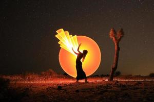 Person Light Painted in the Desert Under the Night Sky photo