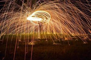Beautiful circle of sparks at night photo