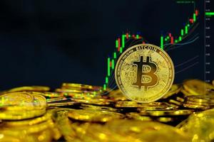 Bitcoin cryptocurrency on pile gold coins a lot of photo