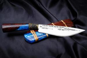 knife custom or Enep in the natural wood scabbard on old table background handmade of Thailand photo