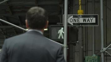 Anonymous businessman in a suit crossing the street in Manhattan video