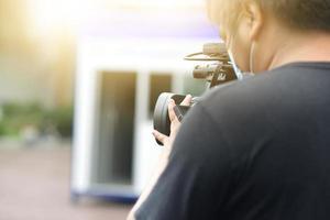 Man take video live streaming news photo