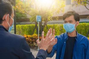 Friends shake hand elbow new normal for prevent coronavirus covid19 photo
