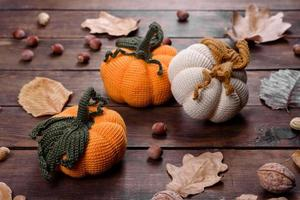 Knitted pumpkins and leaves photo