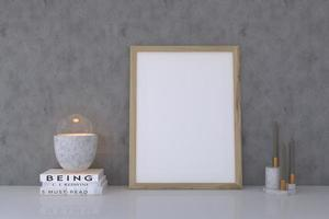 Wooden empty photo frame with decor on concrete wall