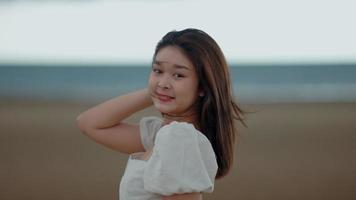 Asian woman walking by the beach video