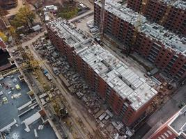Aerial view of a construction site with buildings under construction and equipment photo