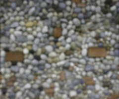 blurred blackground  background made of a wall with pebbles photo