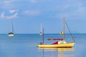 Boats tropical island Koh Phayam Ao Khao Kwai Beach Thailand photo