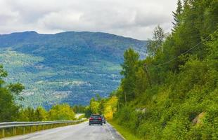 Driving through Norway in summer view of mountains and forests photo
