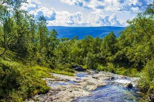 Amazing norwegian landscape beautiful colorful turquoise river waterfall Vang Norway photo