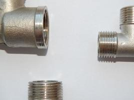 Water, sewer pipes and adapters of different diameters photo