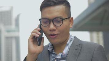 Asian businessman talking phone  video
