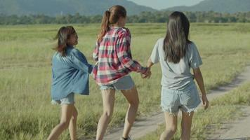 Group of a young Asian woman with friends happy camping in nature having fun. video