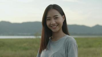 Asian woman smiling look at camera. video