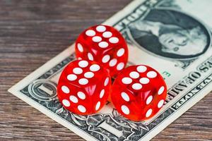 red dices with one dollar banknote on wooden table, last chance concept photo