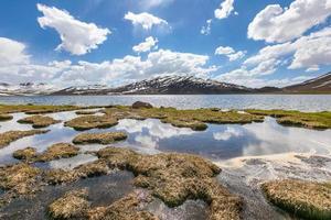 highland plains mountain lake clouds photo