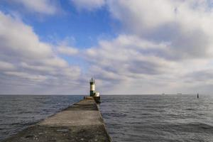 lighthouse on a pier at sea a symbol of hope photo