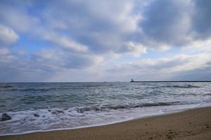 seashore and surf on the beach, no people, secluded vacation spot photo