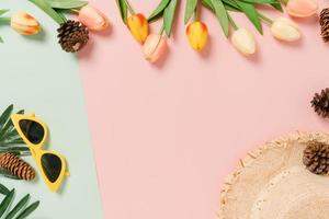 Creative flat lay of travel vacation spring or summer tropical fashion. Top view beach accessories on pastel green pink color background with blank space for text. Top view copy space photography. photo