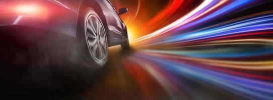 Sport car wheel drifting on lighting photo