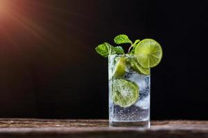 Mojito drink on dark background photo