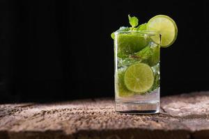 Mojito drink on dark photo
