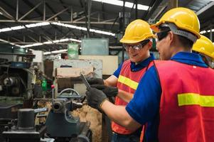 The industrial worker team is working on various projects in a large industrial factory with many equipment. photo