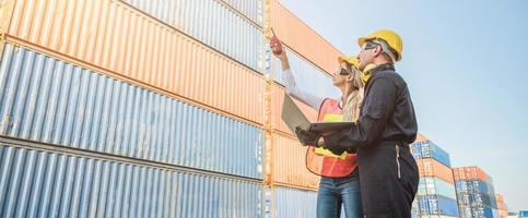 Two foreman man woman worker working checking at Container photo