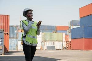 Black foreman woman worker working checking at Container photo