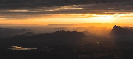 Sunset at Loei Province, Phu Kradueng National Park Thailand. Landscape view from mountain. photo