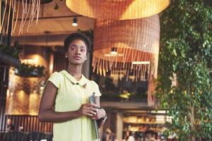 African American business woman stands with a folder in her hands photo