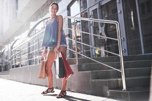 Attractive cute girl in with the bags enjoying in shopping. Favorite activity of all women photo
