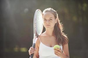 A beautiful woman wearing a sportswear tennis ball. photo