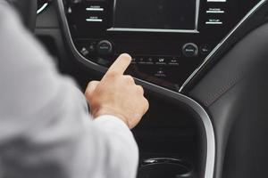 Man includes an audio system in the car. photo