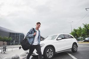 photo of a young man before an exciting trip at the airport.