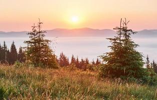Sunset in the mountains landscape. Dramatic sky. Carpathian of Ukraine Europe photo